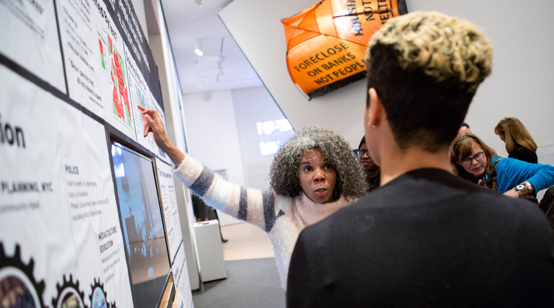"Alicia Boyd, a community activist who helped create ""A People's Monument to Anti-Displacement Organizing,"" speaking with visitors at the Brooklyn Museum. Photo Caitlin Ochs for The New York Times"